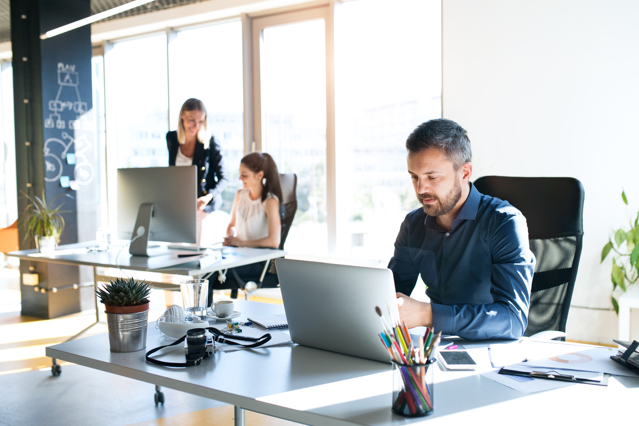 Three business people in the workplace